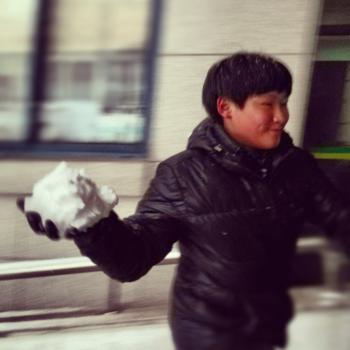 One of my favorite boys, about to pwn some of his friends with an awesome snowball!